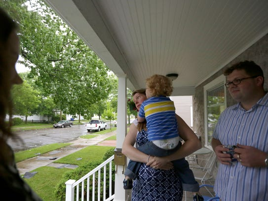 Laurie Frahm and her husband Rick wait on the porch