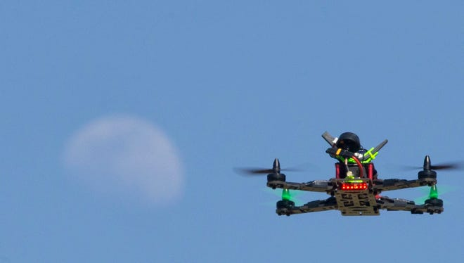 A drone flying in Thude Park in Chandler. Phoenix drone users could face fines for flying too close to government buildings if city adopts an ordinance coming before the City Council Wednesday.