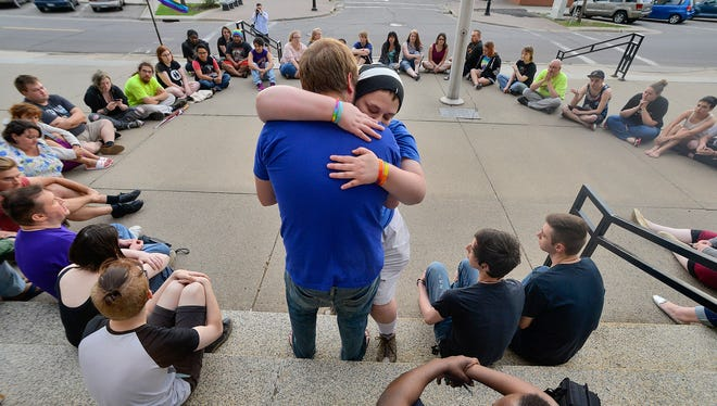 JT Boser embraces Justin Michael Lewandowski as more than 50 people gathered for a vigil at the Stearns County Courthouse Sunday evening, June 12, in solidarity with the victims of the Orlando, Florida nightclub shooting.