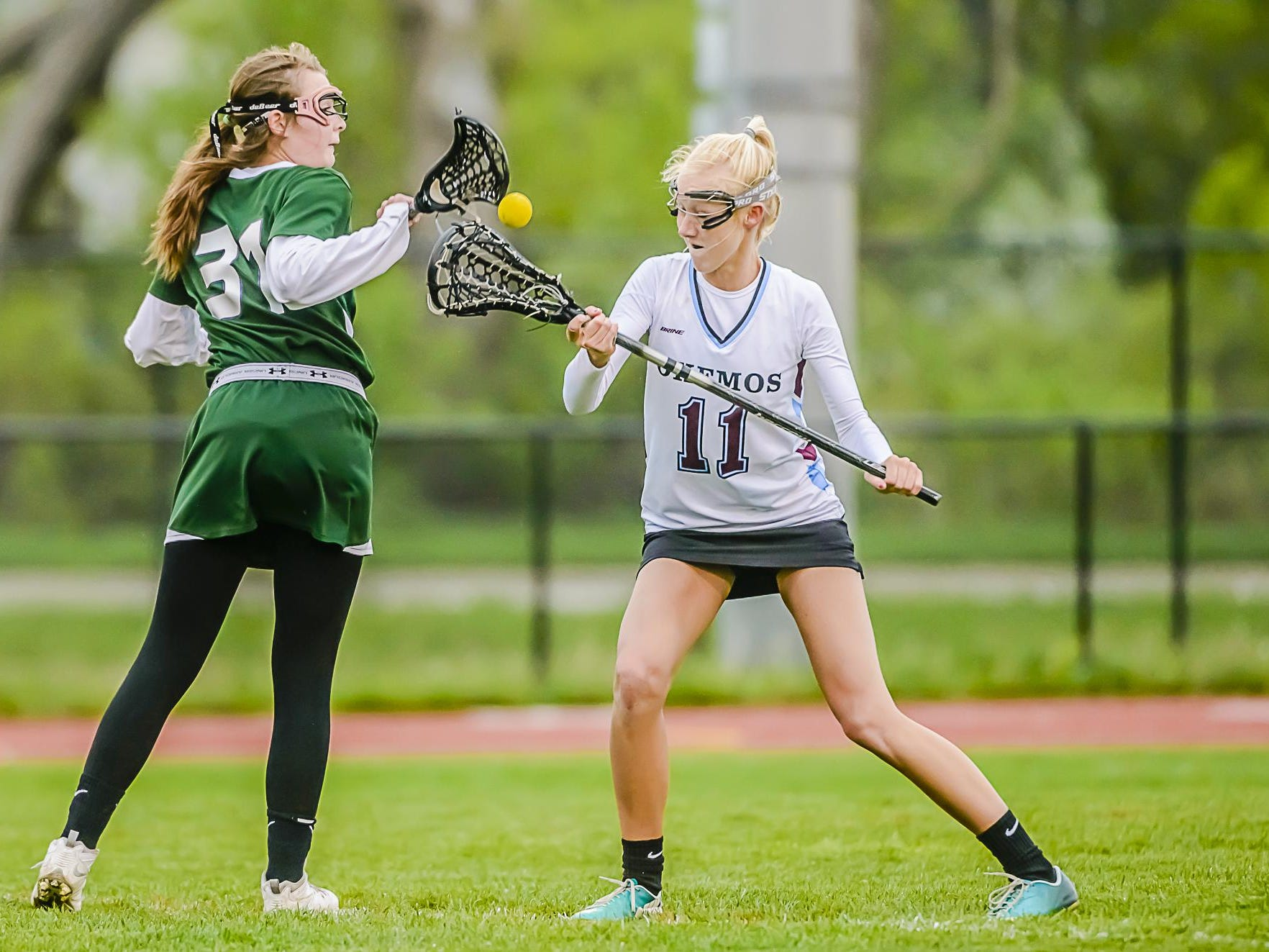 Okemos' Natalie Bloniarz (11) had 39 goals and 31 assists while earning first team all-state honors.