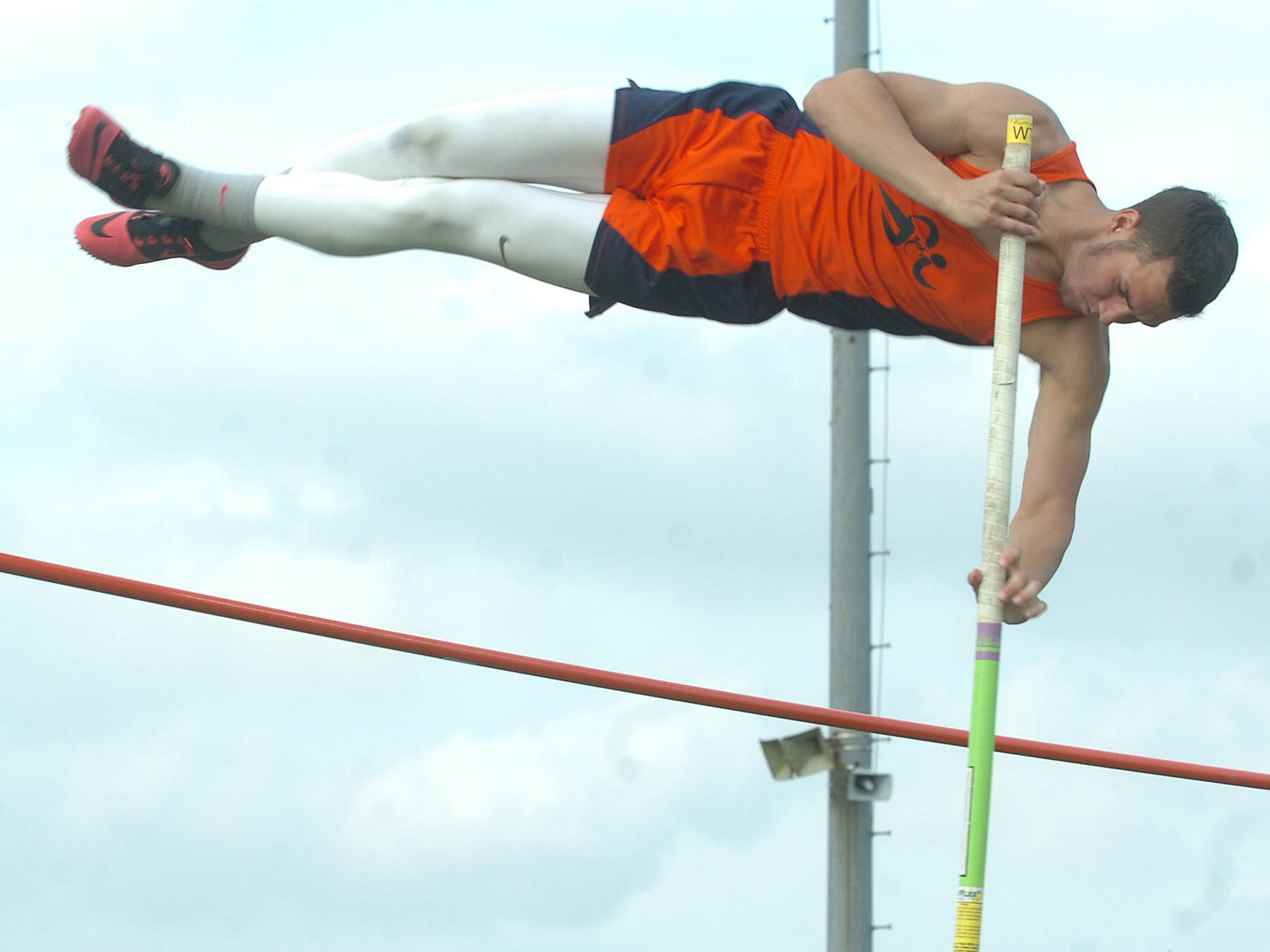Beau Chene's Storm Robin clears in pole vaulting competition held at Eunice High. Robin finished second in Tuesday's parish track meet competition behind North Central's Austin Pitcher.