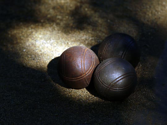 Wooden bocce balls and courts are available for guests at the Parker Palm Springs.