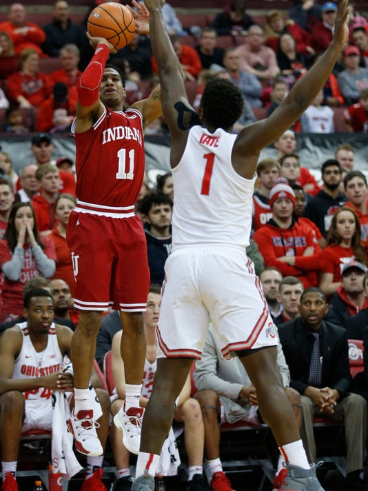 Indiana guard Devonte Green, left, goes up for a shot against Ohio State forward Jae'Sean Tate during the first half of an NCAA college basketball game in Columbus, Ohio, Tuesday, Jan. 30, 2018. (AP Photo/Paul Vernon)
