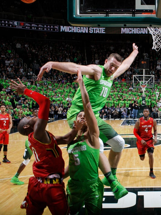 Michigan State's Matt Costello (10) blocks a shot by Maryland's Rasheed Sulaimon, left, as Michigan State's Bryn Forbes (5) also defends during final minute of an NCAA college basketball game, Saturday, Jan. 23, 2016, in East Lansing, Mich.  Michigan State won 74-65. (AP Photo/Al Goldis)