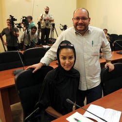 """Washington Post"" Iranian-American journalist Jason Rezaian and his Iranian wife Yeganeh Salehi at a press conference in Tehran, Iran."