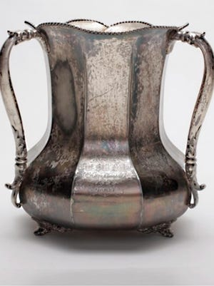 Recognized as the oldest rivalry game trophy in college football, the 8-inch tall, silver-plated, 1899 Territorial Cup started out as a championship prize awarded to league champions the Territorial School Normals by the Arizona Football League.