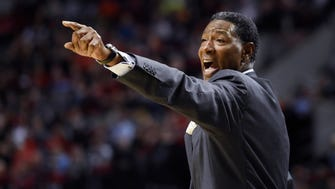 Minnesota Timberwolves coach Sam Mitchell yells out to his team during the first quarter of an NBA basketball game against the Portland Trail Blazers in Portland, Ore., Saturday, April 9, 2016. (AP Photo/Steve Dykes)