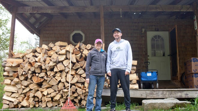 Kasie Enman, 35, stands with her husband, Eli Enman, 38, in front of their house in Huntington last week. Kasie, the 2012 champion, and Eli will both be running the People's United Bank Vermont City Marathon & Relay on Sunday.