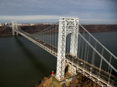 The George Washington Bridge crosses the Hudson River between New Jersey, left, and New York.