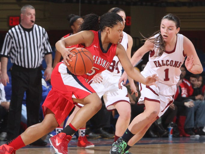 Peekskill's Aubrey Dabbs drives on Albertus Magnus' Elizabeth Benedetto during the Section 1 Class A championship game at the Westchester County Center March 1, 2014. Peekskill won 49-34.