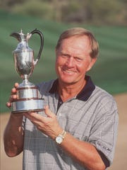 Jack Nicklaus smiles as he poses with the trophy for the 1996 Tradition Tournament at Desert Mountain Course.