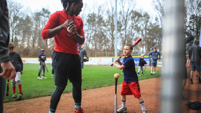 "Cameron Maybin interacted with and gave pointers to young baseball players during his ""Maybin Mission"" baseball clinic, held Saturday morning at UNC Asheville's Greenwood baseball field.  Maybin is a graduate of T.C. Roberson who currently plays for the Los Angeles Angels.