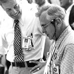 In the Launch Pad 34 blockhouse at Cape Canaveral Air Force Station in October 1968, Deputy Director of Launch Operations Walter Kapryan, left, confers with Director of Launch Operations Rocco Petrone during the Flight Readiness Test for the Apollo 7 countdown.