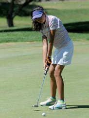Kira Moore sinks a putt en route to posting the best