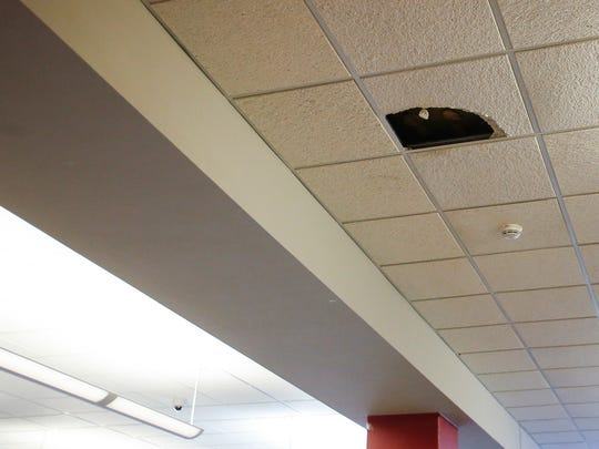 A broken ceiling tile in the cafeteria at Sexton High School seen shortly after lunch. Approximately 45 students were transferred to Sexton this fall as part of a move of the district's cognitive impairment program.