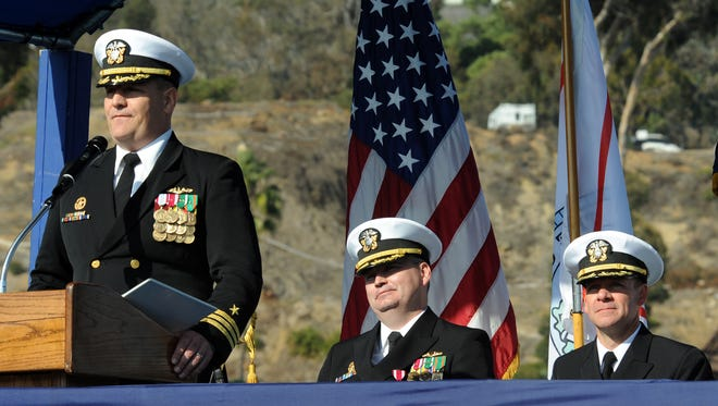 Cmdr. Michael Conner delivers remarks during a change of command ceremony onboard the Los Angeles-class attack submarine USS Oklahoma City. Cmdr. Andrew Peterson turned over command to Conner during the ceremony held Dec. 20, 2013, at Naval Base Point Loma, San Diego.