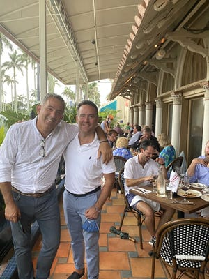 Almond co-owner Eric Lemonides and partner Lee Felty attract a cordial crowd (including Notables editor Krystian von Speidel, seated at far right).