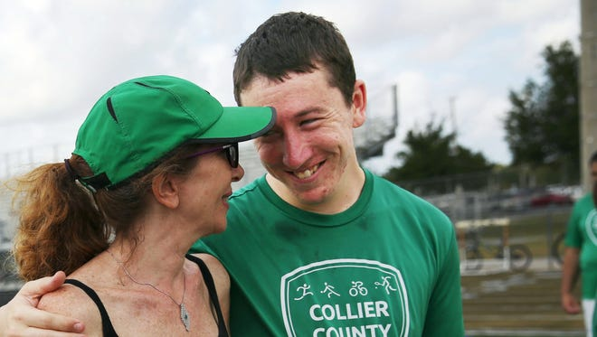 Debby Kays hugs her autistic son Walter Lasek Jr., 23, during his Special Olympics track and field practice at Golden Gate High School on Saturday, April 23, 2016. Kays, along with her husband Terry, is working to build a co-housing community in Naples for people with Autism and their families, through their non-profit organization Adonis Autism.