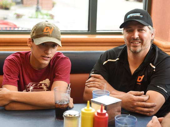 Jonathan Rangel, left, and his father, George Rangel,