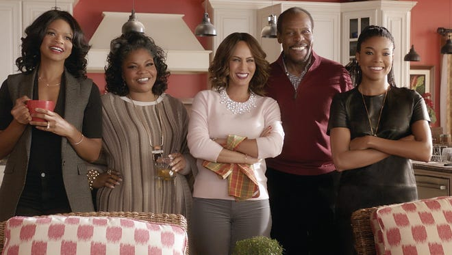 """Cheryl (Kimberly Elise, from left), Aunt May (Mo'Nique), Sonya (Nicole Ari Parker), Walter (Danny Glover) and Rachel (Gabrielle Union) try to make the season bright in """"Almost Christmas."""""""