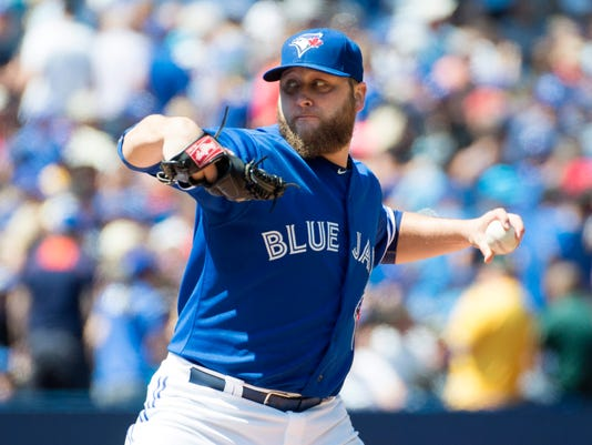 Toronto Blue Jays' starting pitcher Mark Buehrle works against the Oakland Athletics during the third inning of a baseball game in Toronto, Thursday, Aug. 13, 2015. (Darren Calabrese/The Canadian Press via AP) MANDATORY CREDIT