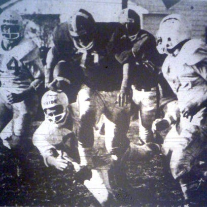 Vineland fullback Tony Tirelli carries the ball during a win over Millville in 1965.