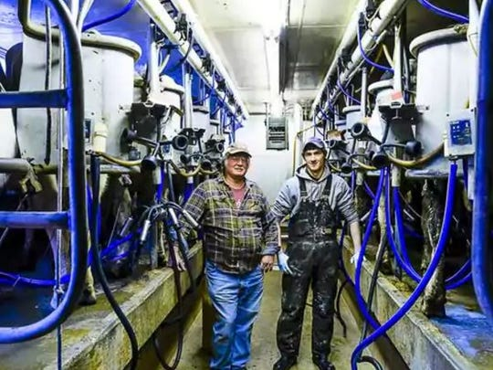 Fogle Farms owner Rick Fogle (left), and Dan Abbott, assistant herd manager, prepare to milk cows in the milking parlor at Fogle Farms.