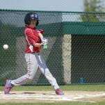 Braylon Essian fouls off a pitch Monday, July 27, during the 10-and-under state little league tournament in St. Clair.