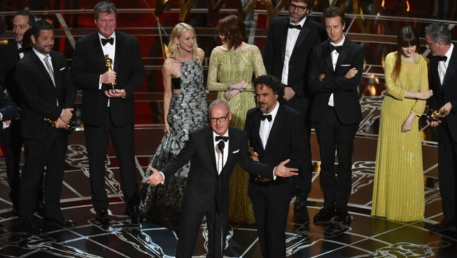 "Star Michael Keaton (center left), director Alejandro Gonzalez Iñárritu and the cast and crew of ""Birdman (or The Unexpected Virtue of Ignorance)"" accept the award for the best picture at the Oscars on Sunday, Feb. 22, 2015, at the Dolby Theatre in Los Angeles."