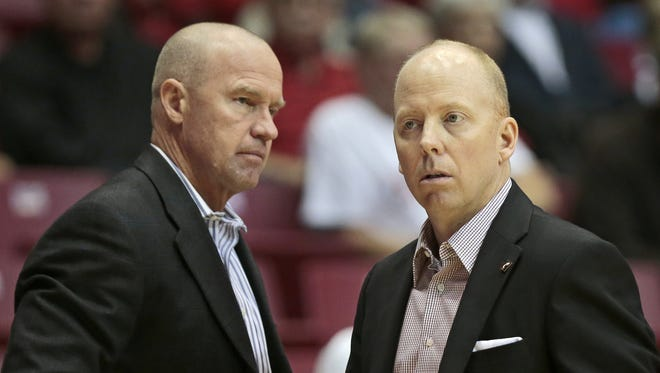 Ex-Cincinnati assistant coach Larry Davis (left) was ousted over allegations of an airplane assault.