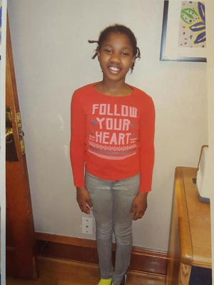 """Police searching for 9-year-old Michele McKinney, described as a 4'6"""" black female. She has shoulder length black hair and was last seen wearing a black shirt with silver stars on the front, blue pants and pink and purple Nike shoes. If you have any information about Michelle's location, please dial 911 or call the Sheboygan Police Department at 920-459-3333."""