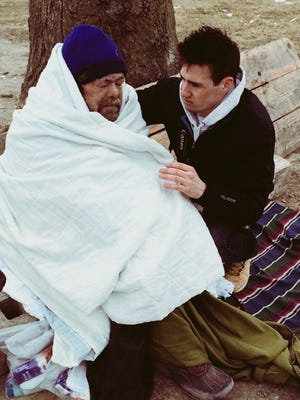 "Filmmaker Anthony Lietz helps a homeless man, ""Phillip,"" who he tended to on a Detroit street."