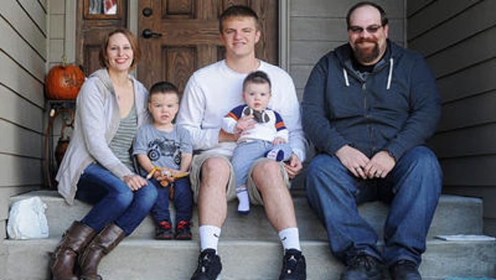 Ashley Elliott; her son, Tristan Elliott, 2; her half-brother, Nick Hasche; her son, Noah Elliott, 8-months; and her brother, Brian Doherty pose for a portrait Friday, Oct. 16, 2015, at Elliott's home in southwest Sioux Falls. Elliott started the Shine a Light on Lung Cancer event in memory of her parents who both died of lung cancer.