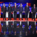 Republican presidential candidates, from left, John Kasich, Carly Fiorina, Marco Rubio, Ben Carson, Donald Trump, Ted Cruz, Jeb Bush, Chris Christie, and Rand Paul take the stage during the CNN Republican presidential debate at the Venetian Hotel & Casino on Dec. 15, 2015, in Las Vegas. (AP Photo/Mark J. Terrill)
