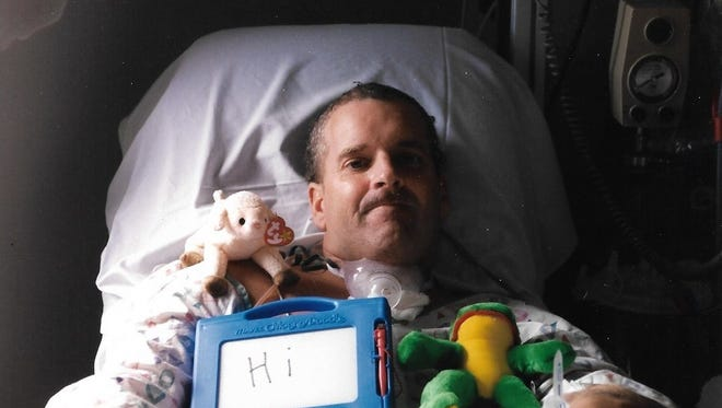 Keith Buff in the hospital after his brain AVM.