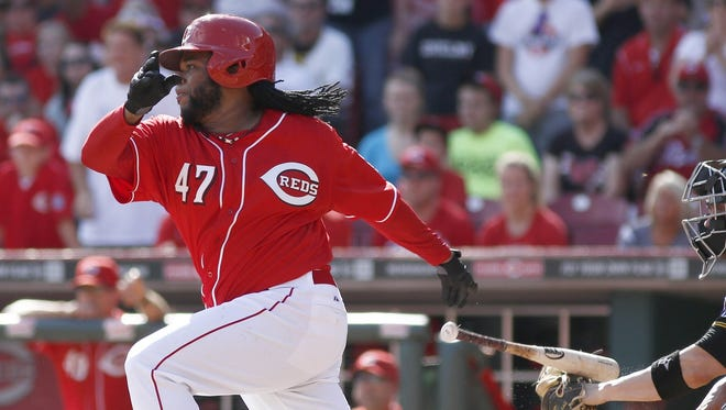 Johnny Cueto used his bat to record his 20th win of the season in Game 162 of the 2014 Reds season.