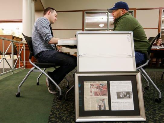 Tom Bieker talks to reporter Stephen Herzog during