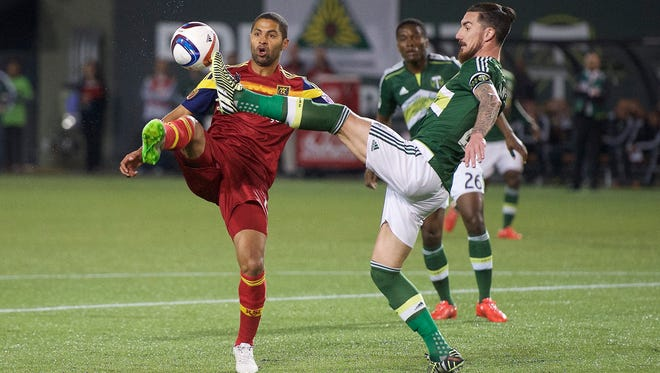 Liam Ridgewell, right, of the Portland Timbers, stops an offensive attack by Alvaro Saborio, of Real Salt Lake, during the first half of an MLS soccer game, Saturday, March 7, 2015, in Portland.