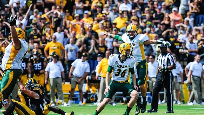 Sep 17, 2016; Iowa City, IA, USA;  North Dakota State Bison place kicker Cam Pedersen (36) celebrates with placeholder Cole Davis (7) after kicking the game winning field goal on the final play of the fourth quarter against the Iowa Hawkeyes at Kinnick Stadium. North Dakota State won 23-21. Mandatory Credit: Jeffrey Becker-USA TODAY Sports