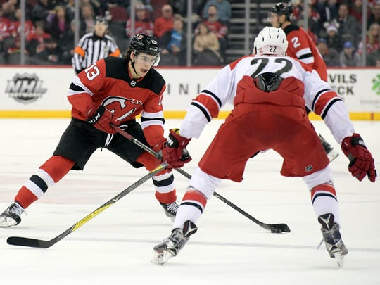 New Jersey Devils center Nico Hischier (13) looks to