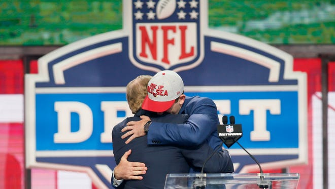 Josh Rosen (UCLA) greets NFL commissioner Roger Goodell after being selected as the number ten overall pick to the Arizona Cardinals in the first round of the 2018 NFL Draft at AT&T Stadium.