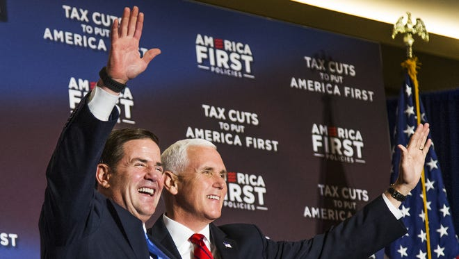 Gov. Doug Ducey welcomes Vice President Mike Pence to the stage at the America First Policies event at the Phoenix Marriott Resort Tempe at The Buttes, Tuesday, May 1, 2018.