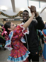 University of Miami tight end David Njoku dances with a folklorico dancer shortly after arriving at the El Paso International Airport Monday. Miami faces Washington State in the Hyundai Sun Bowl on December 26.