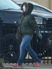 A bundled pedestrian walks near downtown Thursday morning