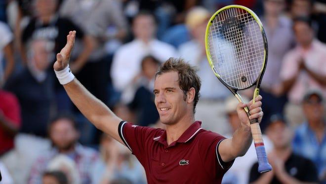 Richard Gasquet of France defeats David Ferrer of Spain 6-3, 6-1, 4-6, 2-6, 6-3.