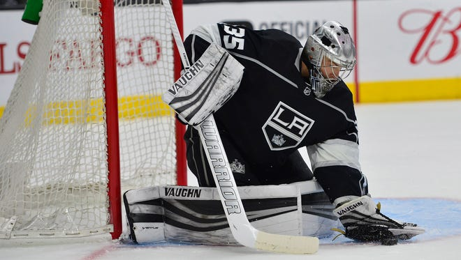 February 3, 2018; Los Angeles, CA, USA; Los Angeles Kings goaltender Darcy Kuemper (35) stops a shot against the Arizona Coyotes during the first period at Staples Center. Mandatory Credit: Gary A. Vasquez-USA TODAY Sports