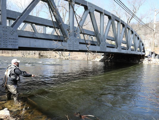 Anglers didn't let the morning cold and the river's high water discourage them from coming out and participating in opening day of trout season.