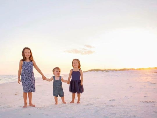 Levi Hughes, center, on the beach with his older sisters, then 9-year-old Lily (left) and then 5-year-old Reese (right). Levi, 3, drowned in a pool during a family vacation to Fort Morgan, Ala., in June.