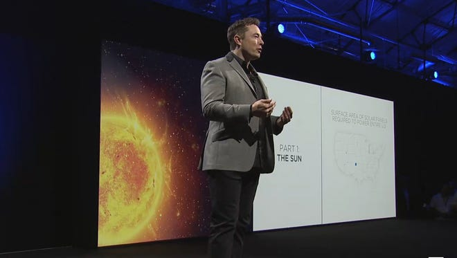 Elon Musk unveils the new Tesla Energy line of storage batteries during a Tesla Live event on April 30, 2015.
