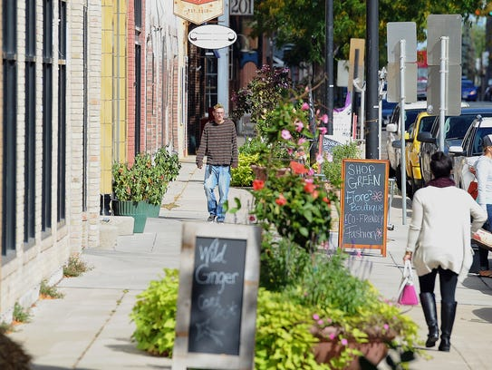 Broadway District stores are set amid overflowing planters